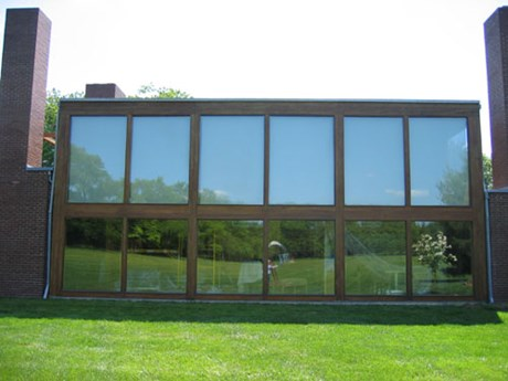 This 2 story glass wall is a striking feature of the Korman House.  Oak supports were restored by Old Village.